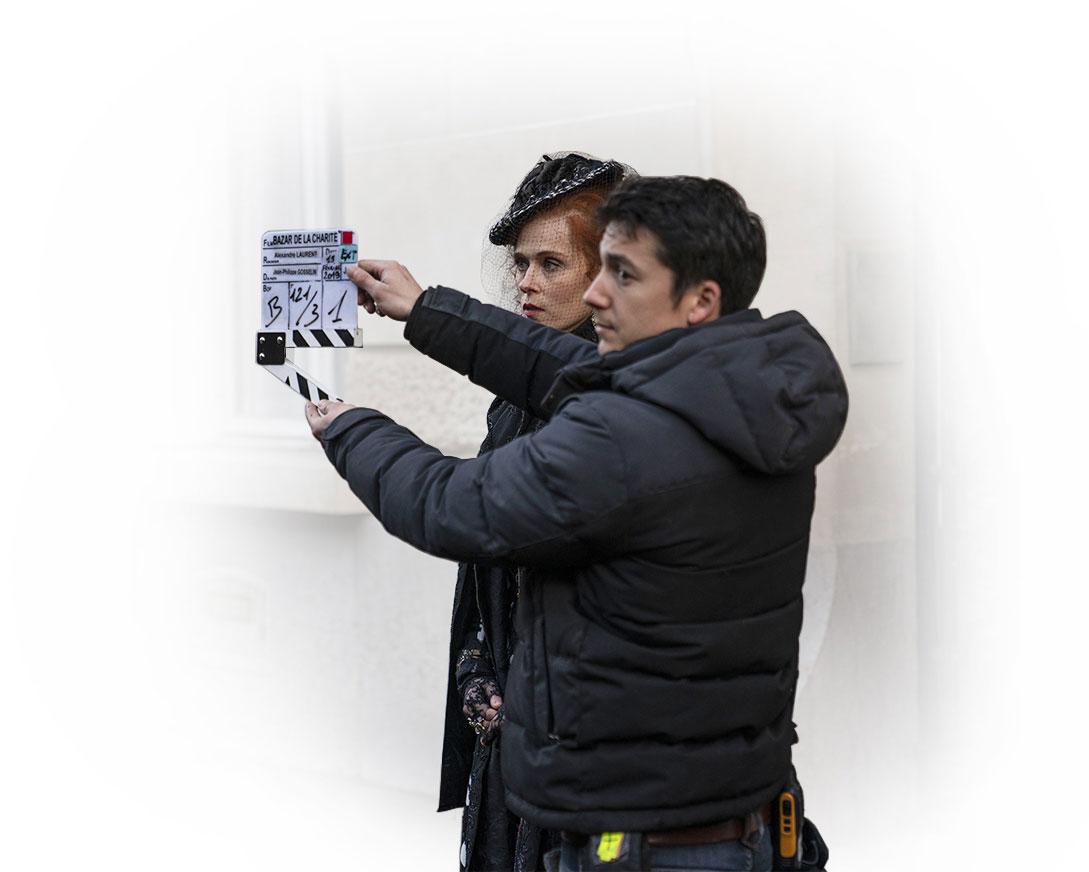 movie staff holding take sign