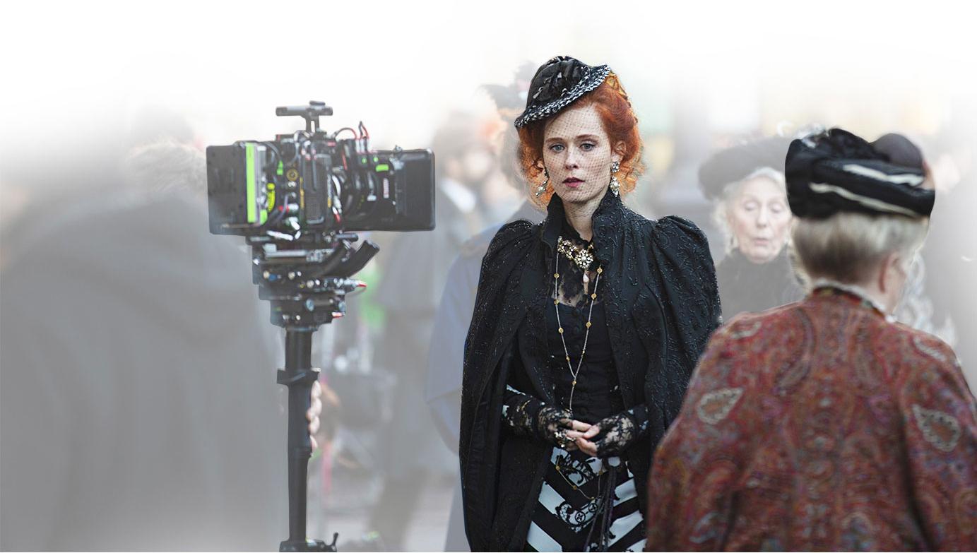 actress next to camera