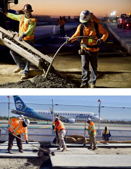 spreading concrete on runway