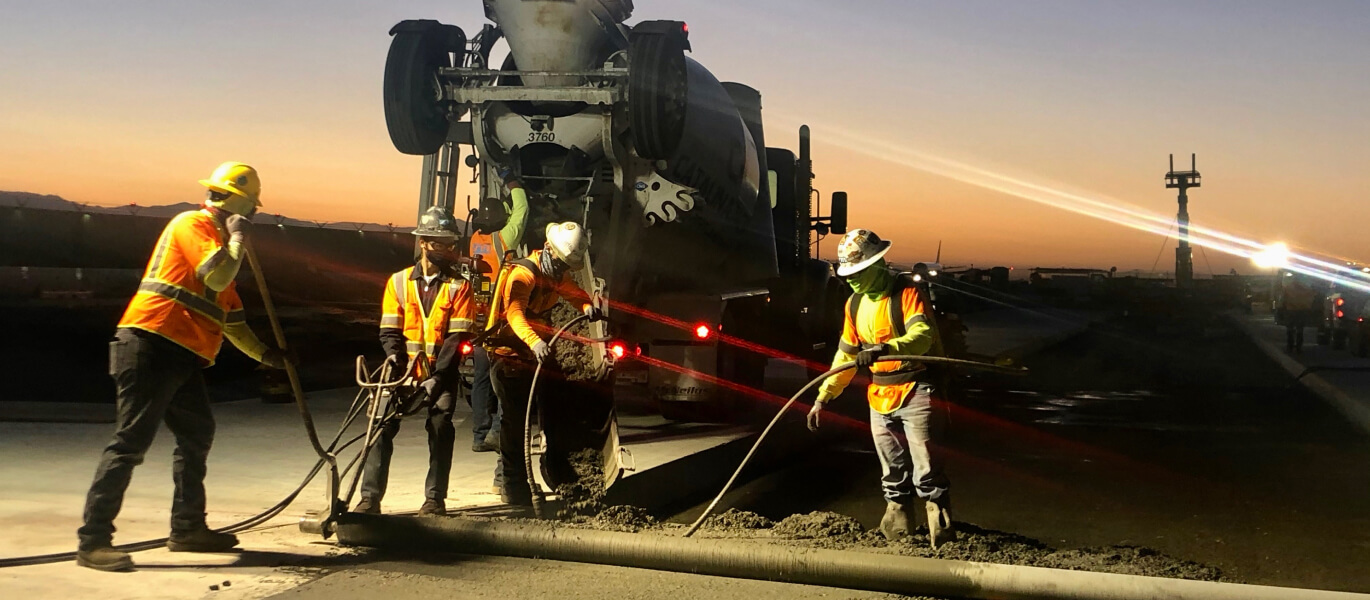 night workers laying concrete